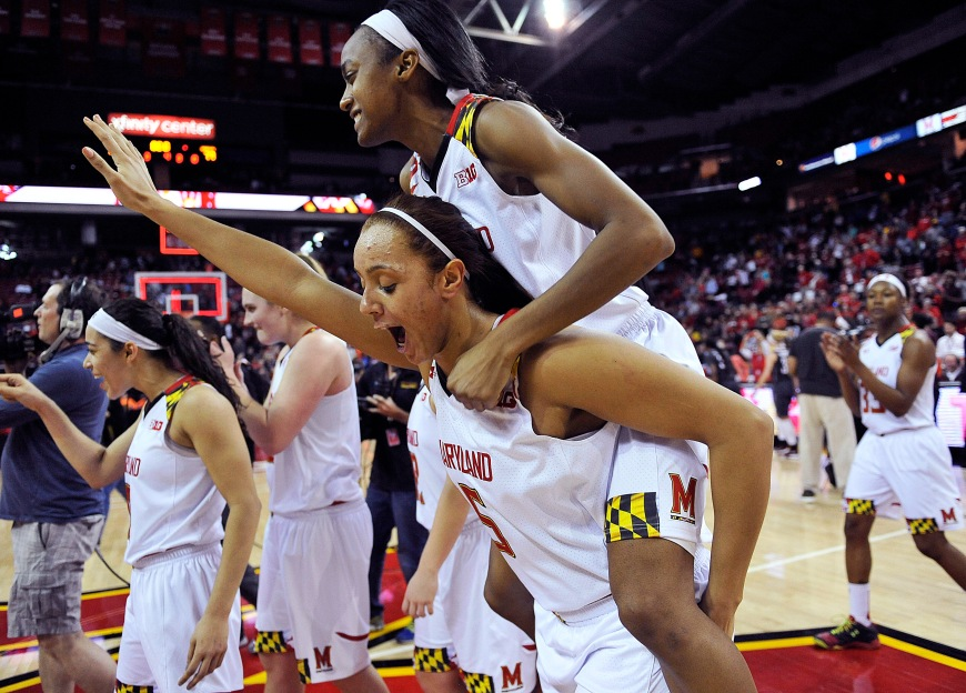 Maryland's Malina Howard carries Shatori Walker-Kimbrough on her back after Maryland defeated Minnesota 110-77 in an NCAA college basketball game and to win the Big Ten Conference regular season title, Sunday, Feb. 28, 2016, in College Park, Md. (AP Photo/Gail Burton)
